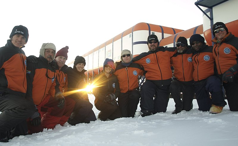 The 47th South African National Antarctic Expedition overwintering team pose in front of the base in the midnight sun