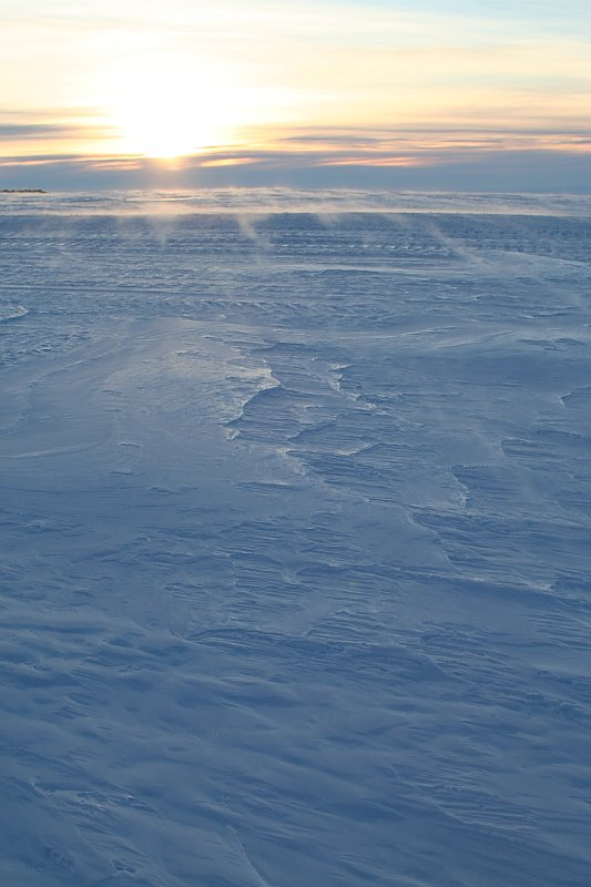Spindrift (fine particles of ice and snow) form ethereal shifting patterns known as \'snowsnakes\' as they are blown across the landscape